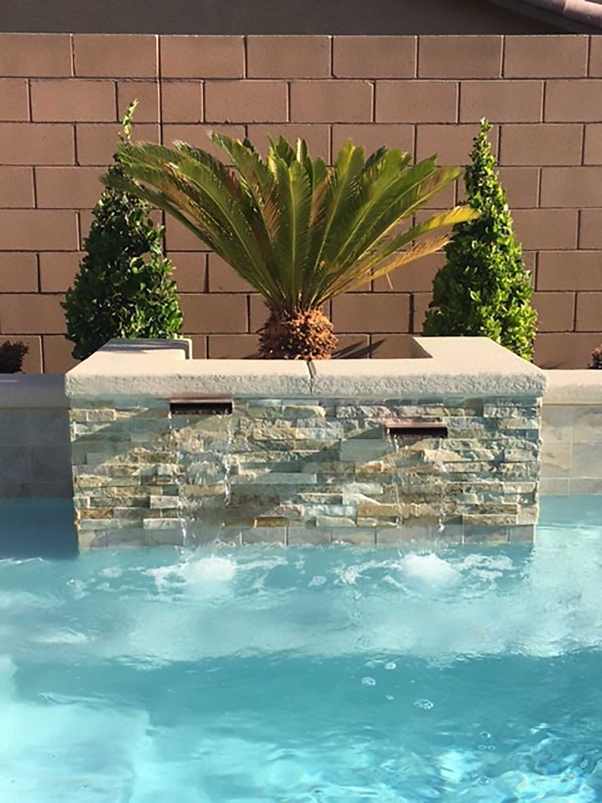 Pool-features-stone-on-pool-copper-scuppers-vegas-1-47 ...